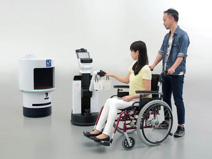 robots toyota aidant personne en fauteuil roulant pour JO 2020