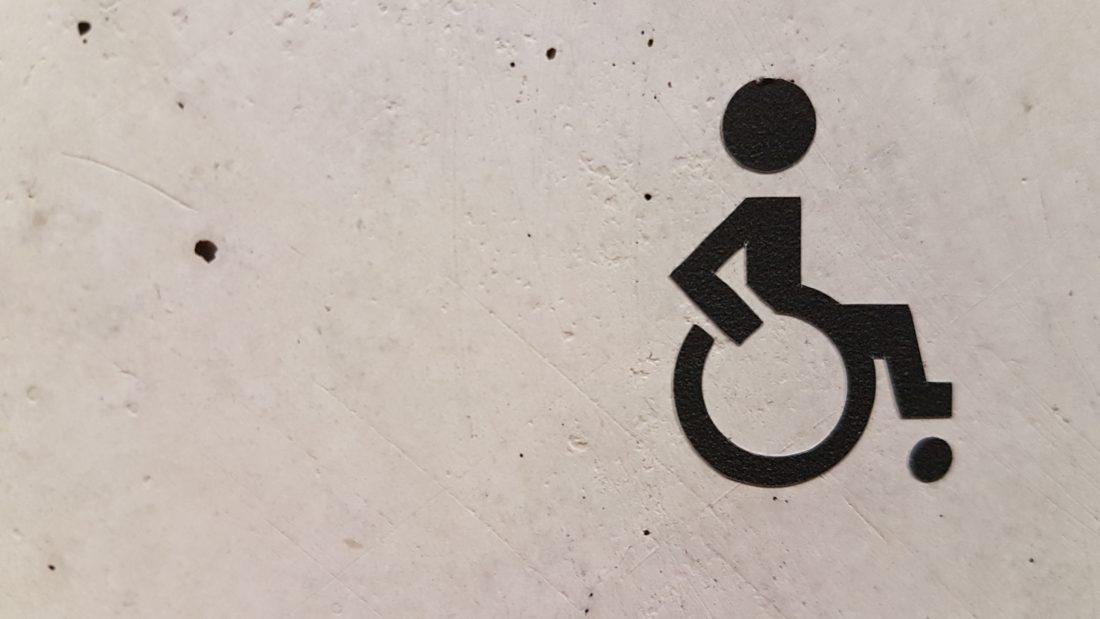 signe fauteuil roulant