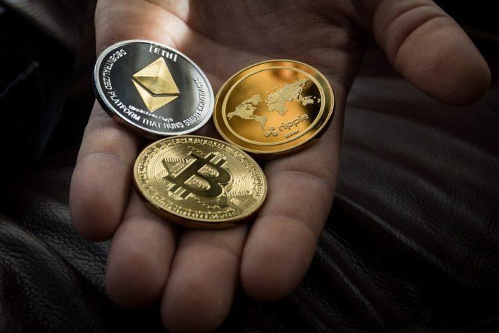 cryptomonnaies main tendue